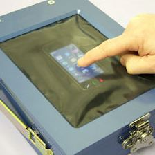 A flexible shielded window to allow the use of a mobile phone within the enclosure for forensic data analysis